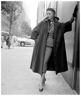 model-is-wearing-a-slim-fitting-tweed-suit-under-roomy-overcoat-by-omar-kiam-brooch-by-trifari-photo-by-nina-leen-new-york-august-1950